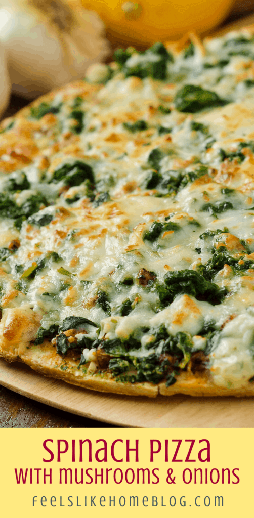 close up of spinach pizza with onions and mushrooms and cheese