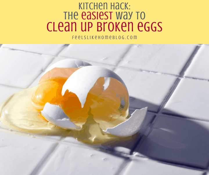 a broken egg on a tile floor