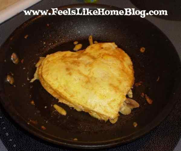 The second skillet with the first egg heart