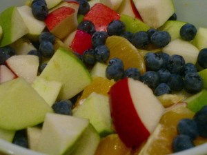 A bowl of fruit salad, with Yogurt and Trifle