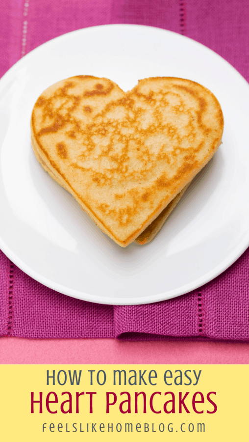a heart pancake on a white plate with a pink napkin