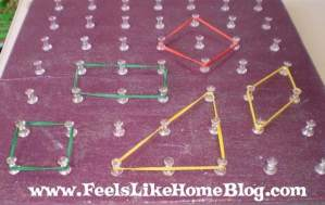 A close up of shapes on the homemade geoboard