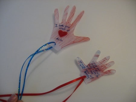 A close up of shrinky dink hands