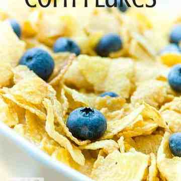 a bowl of corn flakes with blueberries