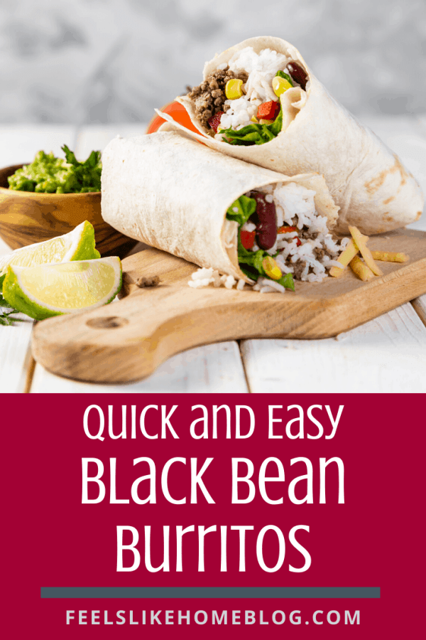 A burrito sitting on top of a cutting board, with black beans and Wrap