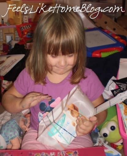 A little girl playing her homemade guitar