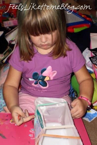 A little girl making a craft