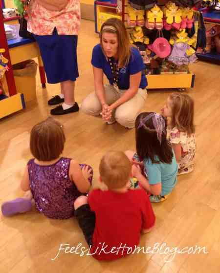 A group of young children sitting on the floor at Build A Bear Workshop