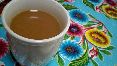 A cup of coffee, with Tablecloth