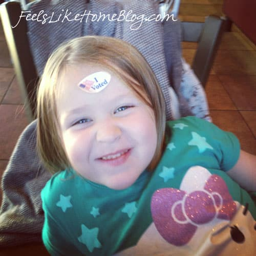 A little girl with a sticker on her forehead