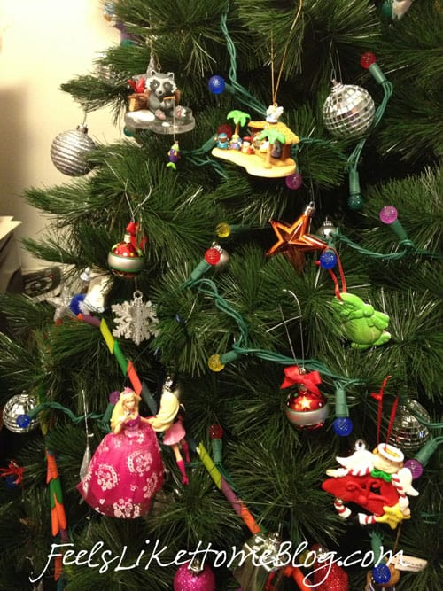 A Christmas tree with multi colored ornaments