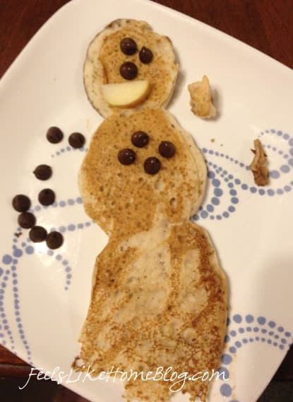 A snowman pancake with chocolate chips for the buttons and eyes