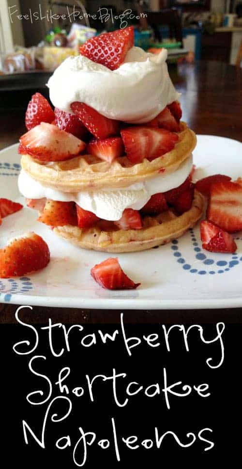 A cake with fruit on a plate, with Strawberry and Waffle