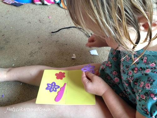 Preschoolers peeling stickers