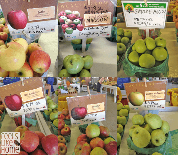 A bunch of different types of apples