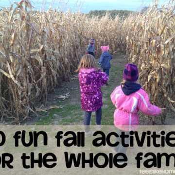 A group of girls running through a corn maze
