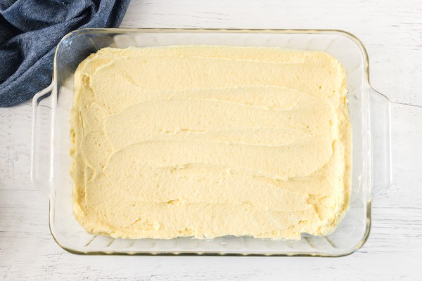 gluten free cherry almond cake batter spread in pan
