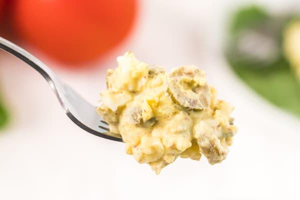 a forkful of egg and olive salad