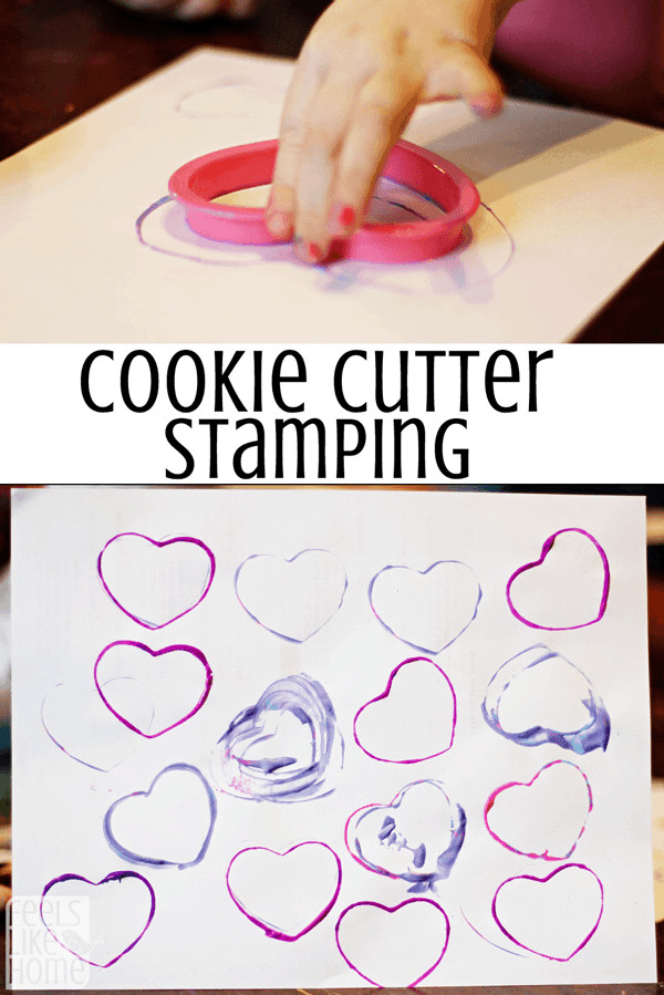 A child using cookie cutters to paint