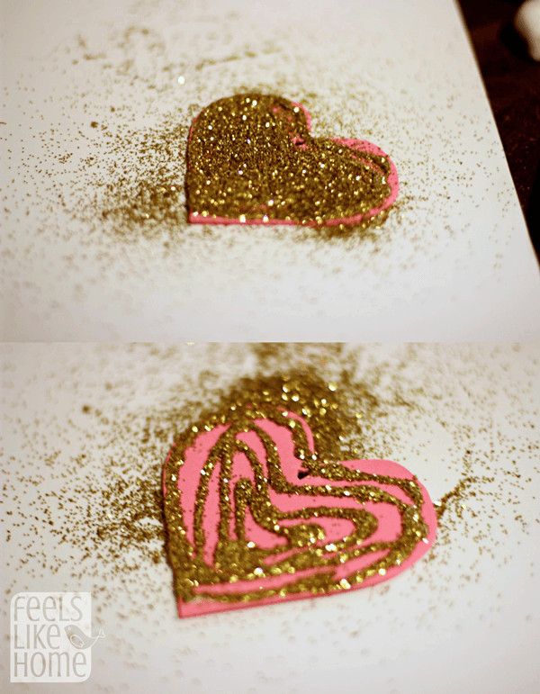 Put glue and glitter on the hearts