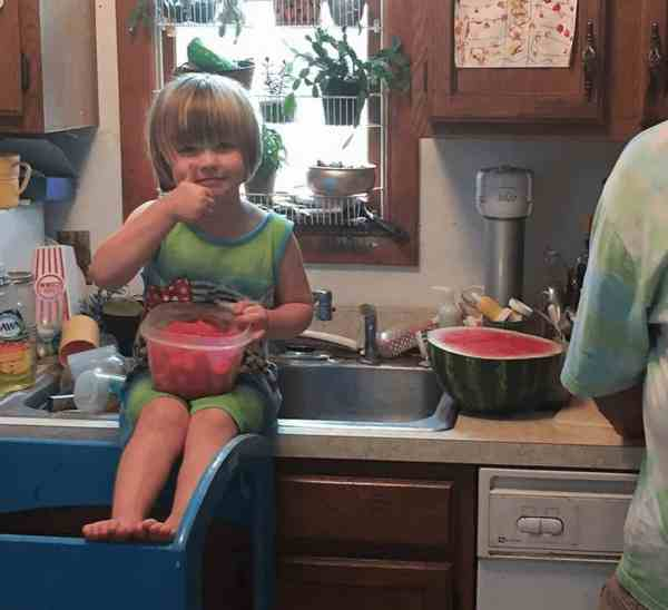 Eating watermelon on the counter