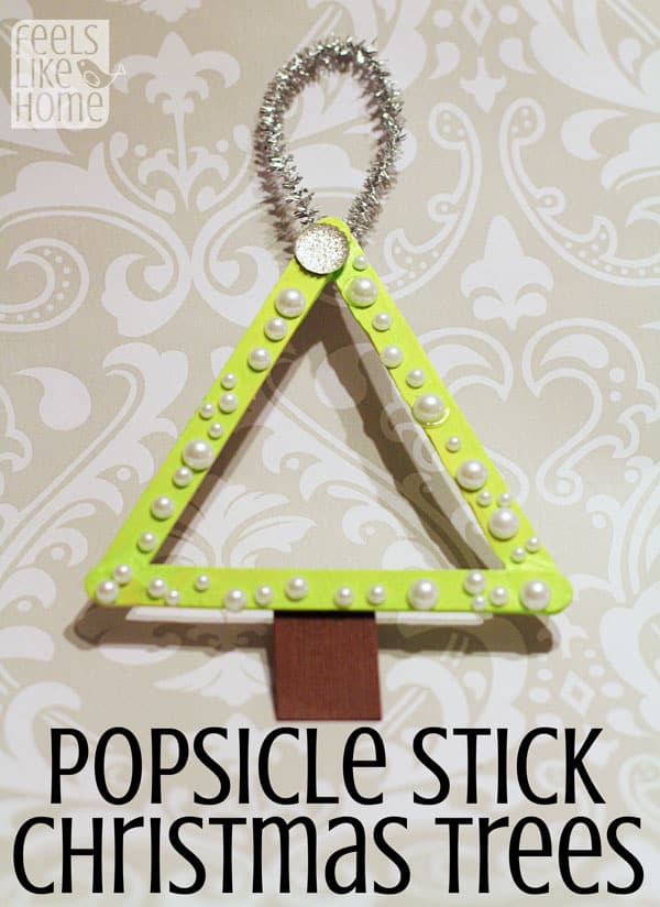 Simple and easy popsicle stick crafts for kids - These cute Christmas tree ornaments will make your home look great! Perfect for a quick craft for toddlers, preschoolers, kids, and teens! DIY holiday projects for boys or girls. Could also be used as awesome, unique picture frames.