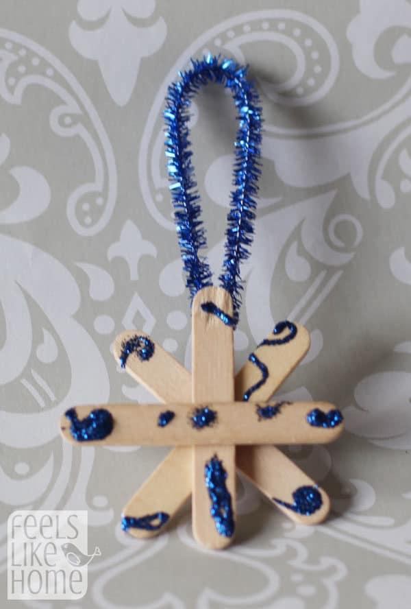 popsicle-stick-snowflake-ornaments-preschoolers-allie-unpainted-blue