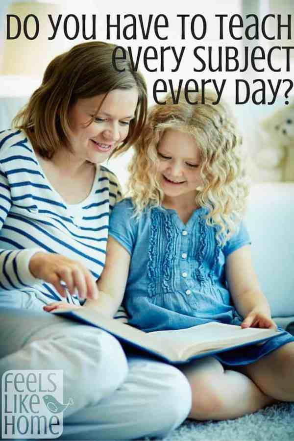 A homeschool mom reading to her daughter