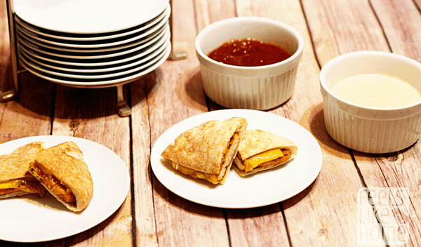 A plate with a sandwich on a wooden table