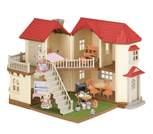 A close up of a doll house