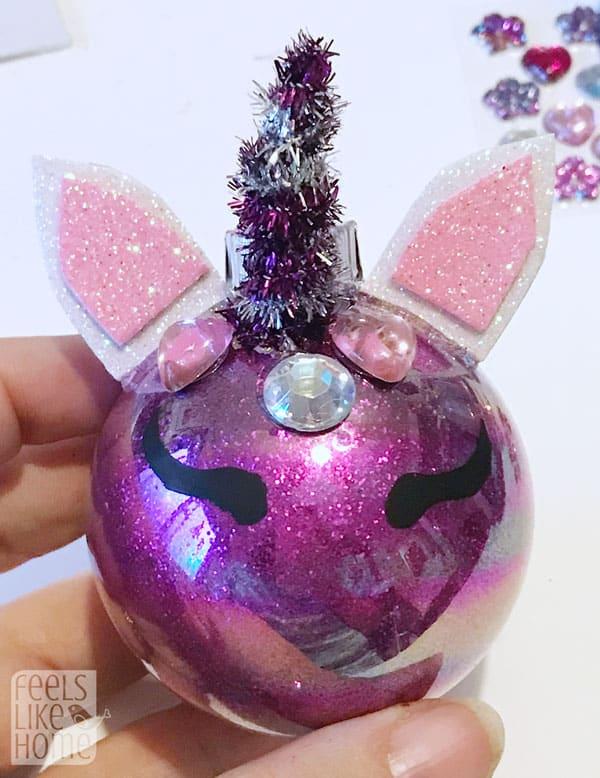 Glue ears on the unicorn behind the jewels