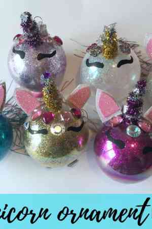 How to make a DIY Unicorn Christmas tree ornament for kids - Even adults will enjoy this cute little craft which is made with glitter, an ordinary glass or plastic clear Christmas ball, pipe cleaners, some jewels, and craft foam. Illustrated tutorial. Handmade holiday decorations.