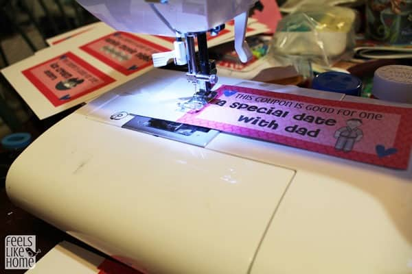 Perforate the coupons by sewing with a sewing machine with no thread
