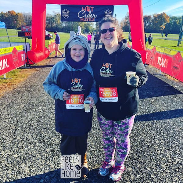 Tara Ziegmont and her daughter posing for the camera at a 5K race