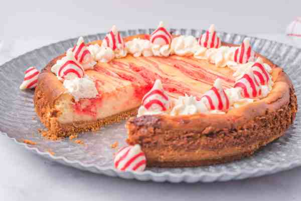 candy cane cheesecake with a slice out