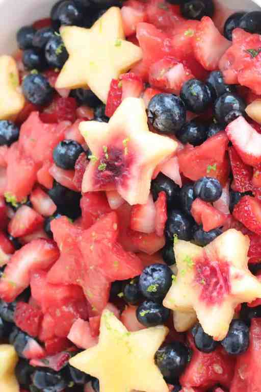 a large bowl full of fruit salad for July 4th