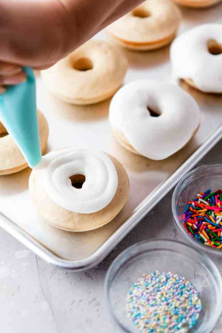 pipe the icing on top of the donuts