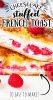 a close up of stuffed french toast with raspberries