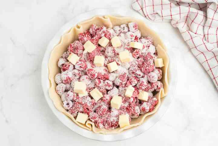 top raspberries with butter cubes