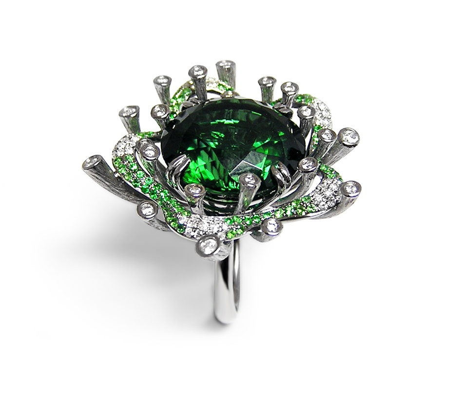 Fei Liu's bespoke Tourmaline Starburst Ring with green garnets and diamonds, in 18ct white gold.