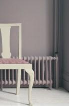 Walls in Brassica No.271 Estate Emulsion, chair in Cornforth White® No.228 Estate Eggshell, radiator in Estate Eggshell - all Farrow & Ball