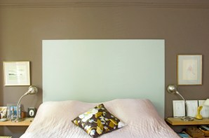 A 'headboard' painted in Pale Powder No. 204 on a London Clay No. 244 wall by Farrow & Ball.