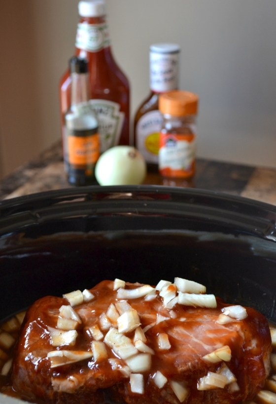 Slow cooker BBQ beef - so easy to make using items you already have on hand. Serve with kaiser buns, coleslaw, horseradish and other favorite BBQ Beef on a Bun toppings!