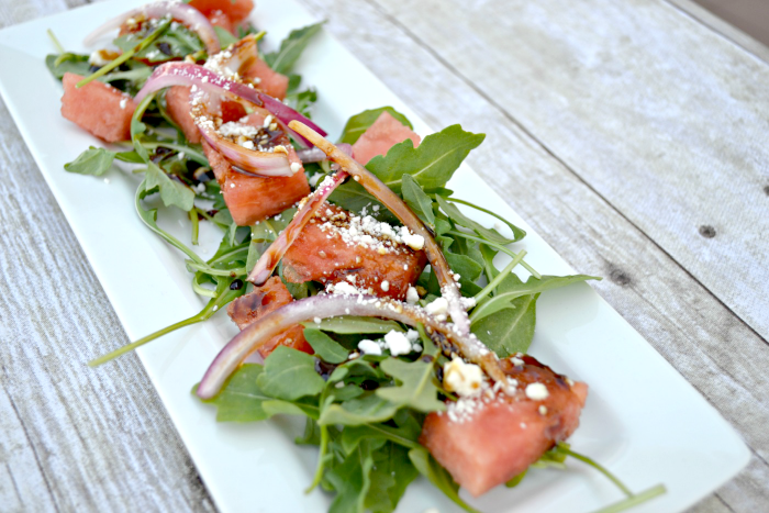 watermelon salad with feta, arugula, pickled onions and balsamic reduction