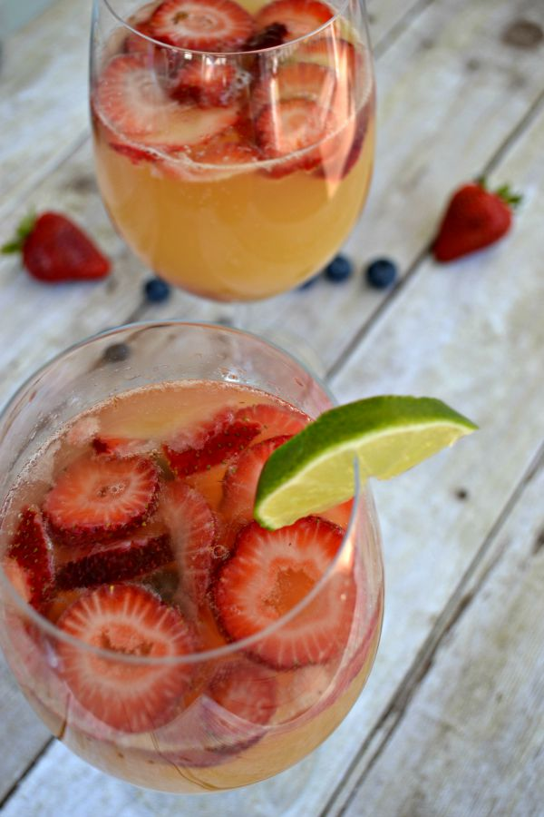 white wine sangria with strawberries blueberries orange juice