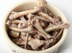image of a bowl of chicken bones