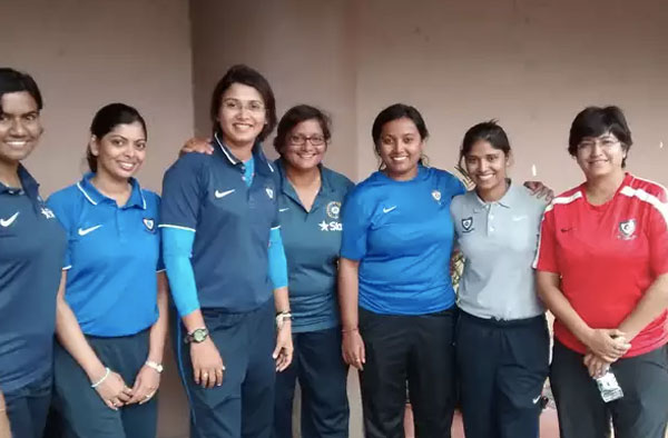 The women-in-charge: (from L-R) physiotherapists Tracy Fernandes and Prachi Lotlikar; coaches Devieka Palshikaar and Purnima Rau; video analyst Aarti Nalge, SnC Abhilasha Sharma and bowling coach Suman Sharma. © Cricbuzz