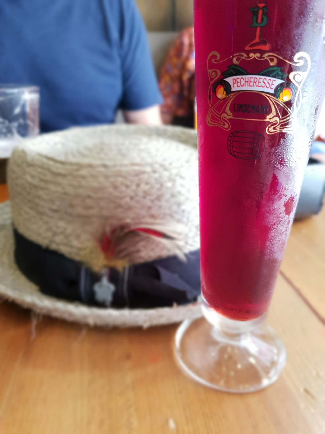 Raspberry beer and straw hat in Central Beers in Malaga. A Foodie's Guide to Malaga.