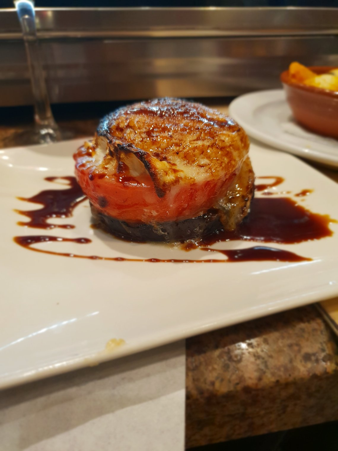 goats cheese tomato and aubergine stack. A Foodie's Guide to Malaga.