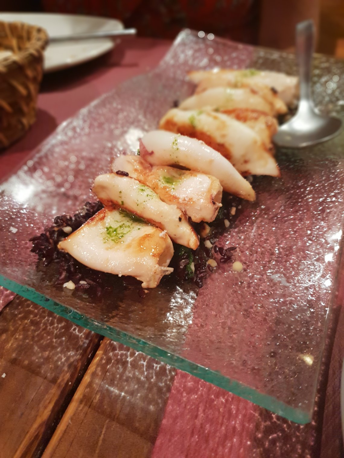 Squid and black rice in Malaga. A Foodie's Guide to Malaga.